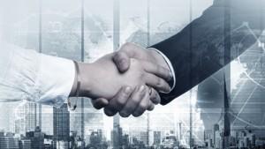 Business handshake on digital background as symbol of global interaction